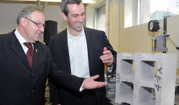 President and founder of Halifax-based CarbonCure Technologies Inc., Robert Niven, explains the technology used to make their concrete blocks to Nova Scotia Premier Darrell Dexter PHOTO: CNW Group/InNovaCorp