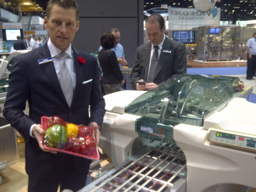 Reiser's Randy Belcot in front of a Fabbri wrapper at Pack Expo 2012.