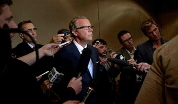 Saskatchewan Premier Brad Wall addresses reporters at the PNWER Summit in July 2012.  PHOTO: Government of Saskatchewan