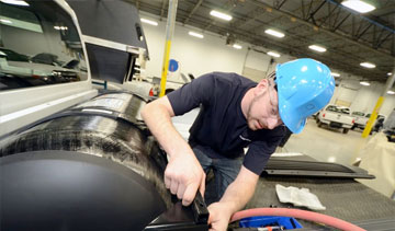 Westport installs its natural gas WiNG Power System on Ford F-250 through F-550 series at Ford's factory in Louisville, KY. PHOTO: Westport Innovations