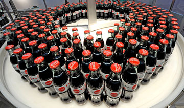 Workers at a Brampton, Ont., Coca-Cola bottling plant approved a new three-year deal by a vote of 83 per cent, ending a three-week strike. PHOTO Coca-Cola