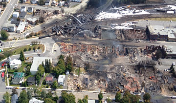 An aerial shot shows the aftermath of the derailment, explosions and fire that leveled part of Lac-Megantic, Que., July 6, 2013. PHOTO Transportation Safety Board of Canada