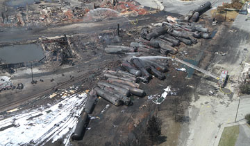 The charred remains of tank cars involved in the July 6 rail disaster in Lac-Megantic, Que. PHOTO Transportation Safety Board of Canada