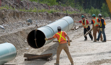Workers install pipe in Jasper National Park as part of the Anchor Loop Project. PHOTO Kinder Morgan Canada