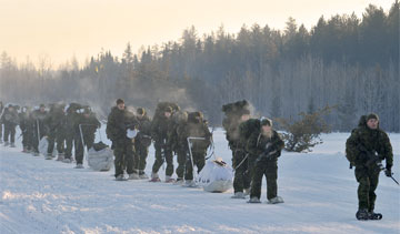 Canadian Brigade Group 33 trek with their snowshoes and kit  during winter training. PHOTO: MCpl Tanya Tobin © 2011 DND-MDN Canada