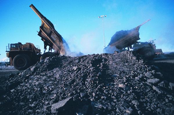 trucks deliver about Mining trucks deliver 500,000 tonnes of oilsand per day to Suncor's ore preparation plants. PHOTO Suncor