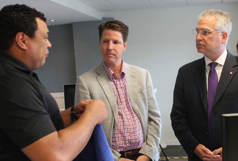 Minister Gary Goodyear (Left) and MP Bernard Trottier take in a tech demonstration at Tri-D Technologies in Toronto. PHOTO: FedDev Ontario