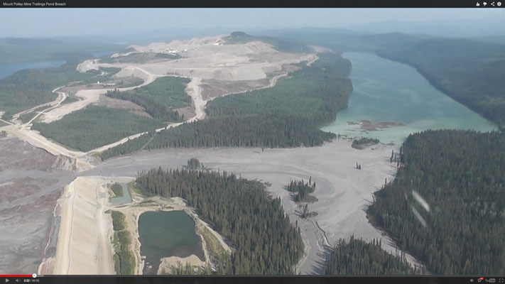 Screen capture from a video showing a tailings pond breach in Northern B.C.