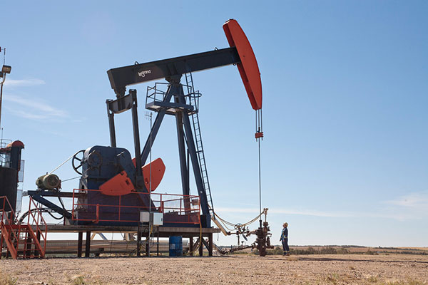 An employee inspects a pumpjack at Husky's Pikes Peak South oil site in Saskatchewan. PHOTO Husky Energy