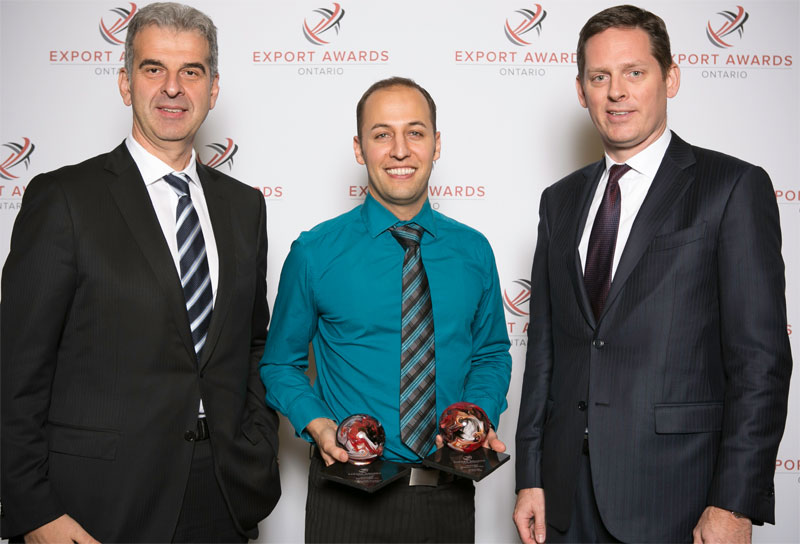 Dave Kroetsch, president of Aeryon Labs Inc. (centre) with his two Ontario Export Awards, including the top award for Exporter of the Year. He is joined by (left) Frank Venturo, senior vice-president and country head of business banking with HSBC Canada, and (right) Daniel Leslie, senior vice-president and head of corporate banking for Canada at HSBC. HSBC was the platinum sponsor of the Ontario Export Awards