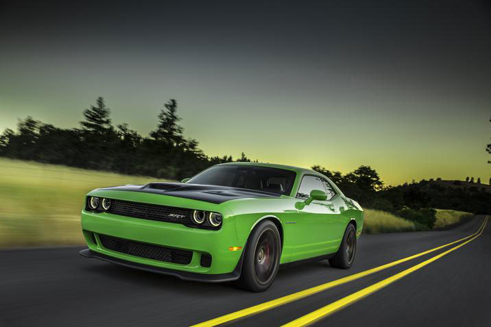 With a 0-to-60-mph time of just 3.7 seconds and a quarter-mile time of only 11.2 seconds, the Challenger SRT Hellcat is among the fastest production cars in the world and easily outshines America's other muscle cars.  PHOTO: Chrysler Group LLC