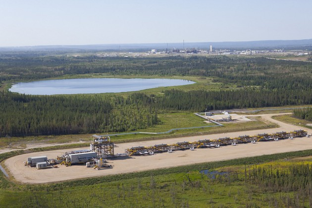Aerial of Nexen's Long Lake pad 13 in the foreground with the Long Lake SAGD processing facility in the distance. PHOTO: Courtesy of Nexen