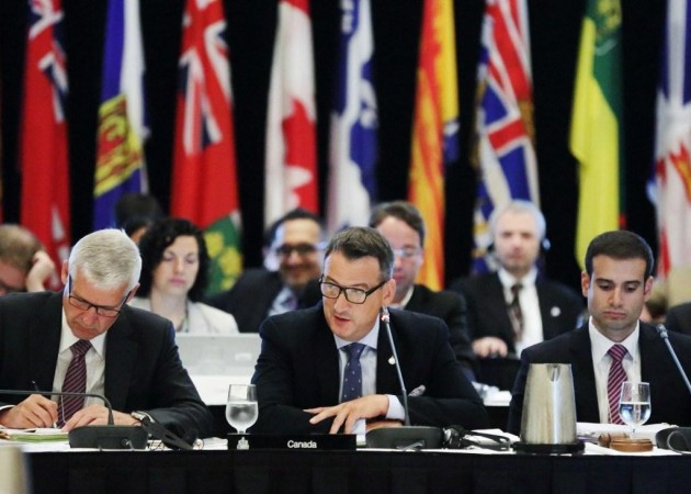 Greg Rickford, Canada's Minister of Natural Resources, calls the 2015 Energy and Mines Ministers' Conference to order in Halifax, Nova Scotia. PHOTO: CNW Group/Natural Resources Canada