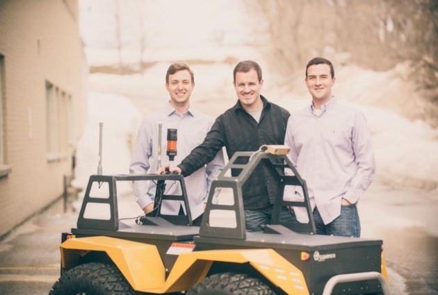 Cleathpath founders Bryan Webb, Ryan Gariepy and Matt Rendall with the Grizzly.  The company's Silverback will recast the company's automated technology into a bot capable of moving pallets as heavy as 3,000 kilograms. PHOTO ClearPath Robotics
