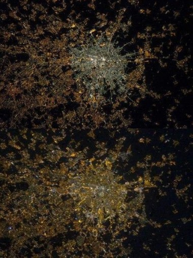 Two images of Milan seen from space. The top image shows the city centre in 2015 after LED installation while the bottom image shows less intense light in 2012 before LEDs were installed outside. PHOTO: NASA/ESA