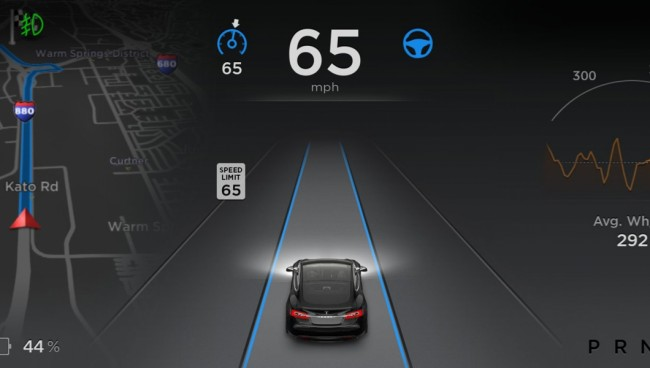 The automaker's latest addition to its tech-filled vehicles allows drivers to take their hands off the wheel - though they do so at their own risk. PHOTO: Tesla