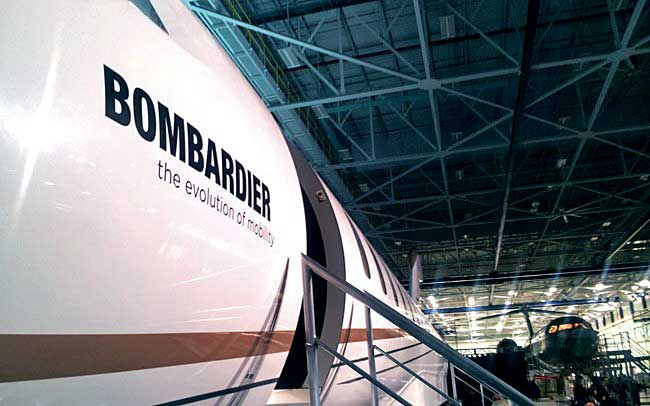The mock-up of Bombardier's Global 7000. The first of five flight test vehicles on the assembly line in the background. PHOTO: David Kennedy