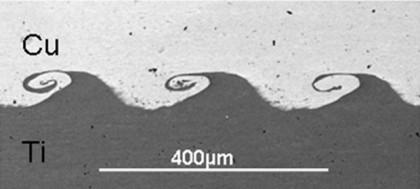 Microscope view of copper (top) welded to titanium (bottom) using a new technique. PHOTO: Courtesy of Glenn Daehn, Ohio State University