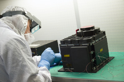 Technician preparing the OLA sensor head for testing at NASA's Goddard Space Flight Center in Baltimore, Maryland. PHOTO: NASA / Goddard / Debora McCallum