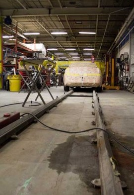 A stripped-down vehicle on the INKAS shop floor awaiting its bulletproof transformation. PHOTO: David Kennedy