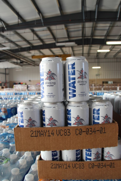 AB InBev is shipping more than 50,000 cans of water north in response to the Flint Water crisis. PHOTO: AB InBev