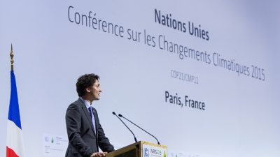 Trudeau speaking at the COP21 Conference in Paris, where he delivered a similar message about redefining Canada's economy. PHOTO: Government of Canada