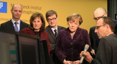 German Chancellor Angela Merkel, who holds a doctorate in physics switched on the reactor. PHOTO: Norbert Fellechner/IPP