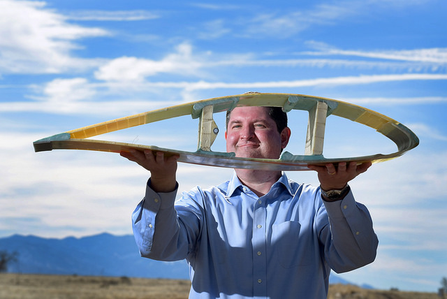 Todd Griffith shows a cross-section of a 50-meter blade, technology that could lead to the massive 200-metre blades. PHOTO: Randy Montoya