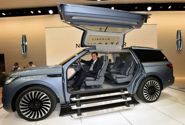 The posh luxury behemoth concept shows huge gull-wing doors that cover the first two rows of seats, but they're too heavy to include in the production models. PHOTO: Ford Motor Co.