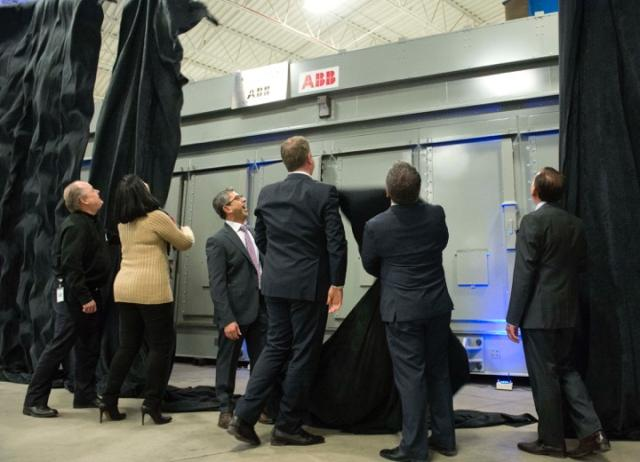 Fadi Emeid (centre), president and CEO of Elias Custom Metal with other government and business leaders at the unveiling of the first Ontario-built e-house. The company hopes its new expertise will lead to further orders. PHOTO: ECM
