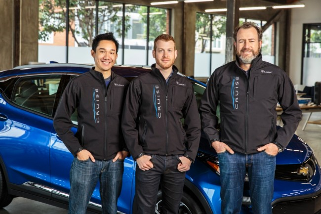 General Motors President Dan Ammann (right) with Cruise Automation co-founders Kyle Vogt (center) and Daniel Kan (left). PHOTO: General Motors