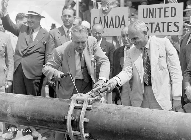 Inauguration of the the pipeline at the U.S. Canada border in 1941. PHOTO: Library and Archives Canada