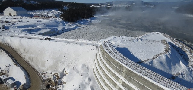 Construction of the cofferdam at Muskrat Falls. The major infrastructure project is currently behind-schedule and over-budget. PHOTO: Nalcore Energy