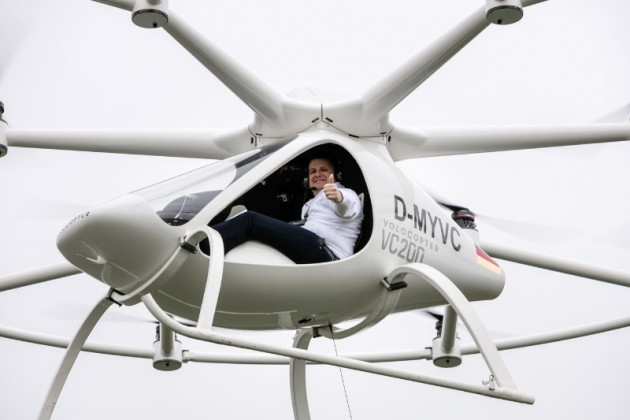 e-volo Managing Director Alexander Zosel gives thumbs up  as he pilots the Volocopter at an Airfield in Southern Germany. PHOTO:PRNewsFoto/e-volo