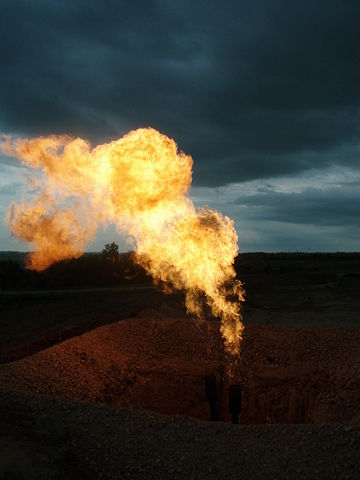 Flaring of gas at a Bakken formation production site. PHOTO: Joshua Doubek, via Wikimedia Commons