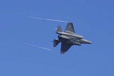 An F-35 Lightning II maneuvers over an airbase in Florida.