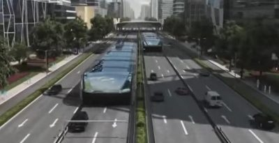 The new bus design would let cars pass under the vehicles even as they made stops, eliminating a significant strain on city streets, and potentially, the environment. PHOTO: New China TV/YouTube