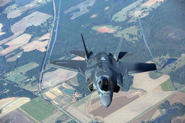 A variant of Lockheed Martin's F-35 in-flight over the U.S. The aircraft program has been the source of controversy in Canada as the Air Force looks to replace its aging aircraft
