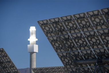 A thermal storage tower uses solar energy to store heat in molten salt. The stored energy can then be converted to electricity using turbines. PHOTO: SolarReserve