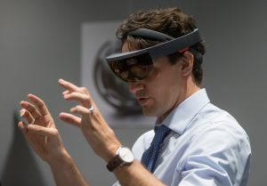 Prime Minister Justin Trudeau tries out Microsoft's HoloLens at the official opening of the Microsoft Canada Excellence Centre in Vancouver. PHOTO: Microsoft News Centre Staff