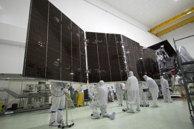 Technicians at Astrotech's payload processing facility in Titusville, Fla. stowing the second solar array against the body of NASA's Juno spacecraft. PHOTO: NASA/JPL-Caltech/KSC