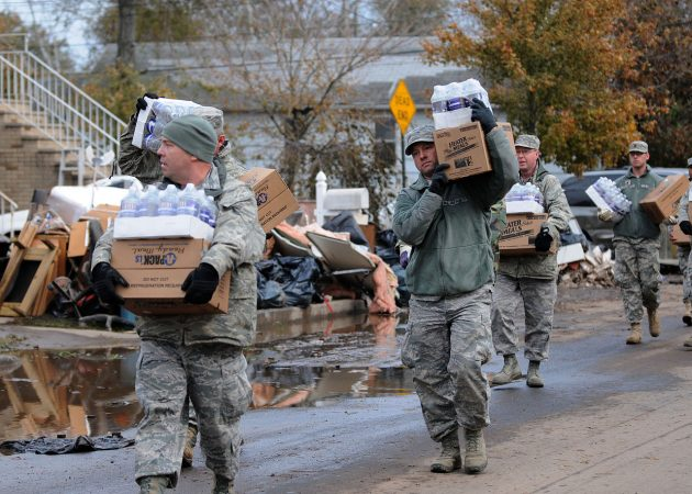 New York Air National Guard taking water and cases of food to local residents in Staten Island, Nov. 2, 2012, after Hurricane Sandy took down power lines and caused massive destruction to many homes in the area PHOTO: New York Air National Guard Tech. Sgt. Jeremy M. Call