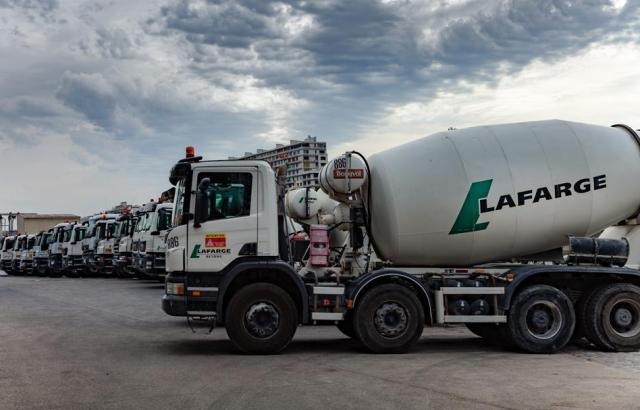 Associated Cement Companies : Cement giant lafarge admits making deals with armed groups