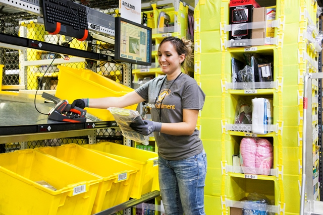 Get your stuff and go: Amazon opens store with no cashiers